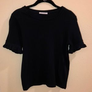 Black T-shirt with ruffle sleeves.